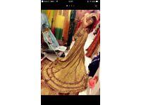 Maroon and gold bridal lengha