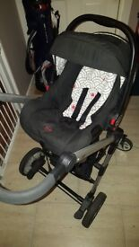 Black travel system...includes carrycot, pushchair seat and car seat.