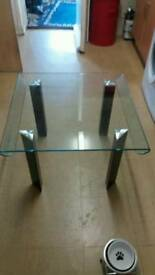 Smoked glass coffee table.