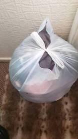 Big bag of woman's clothes