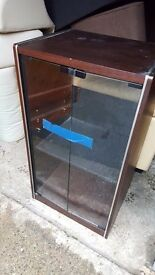 Small glass cabinet.