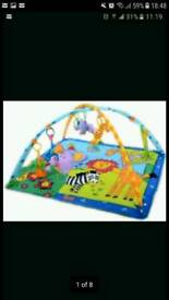 Baby play mat musical and light with all toys' s and mirror + a free musical toy