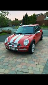 Red Mini one 1.6 petrol car with Mini Cooper extras