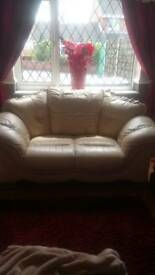 Two seater cream leather settee