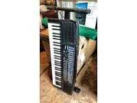 Casio Tonebank keyboard and stand. .