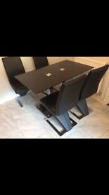 Dining table and chairs Italian leather only 6 months old