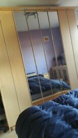 Wooden double bed and two side drawers and 4 closet wardrobe
