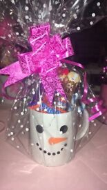 Character glasses and mugs and snowmen mugs filled with sweets