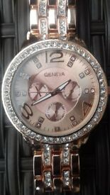 rose gold coloured watch and 2 jewellery sets new.