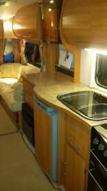 Immaculate 2008 four berth family caravan with motor mover, awning and accessories