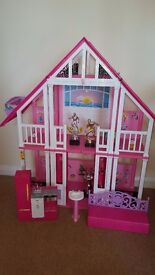 Plastic barbie house plus accessories