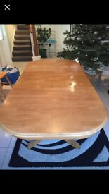 Large Solid Wood Dining Table than can be adjusted through roller system