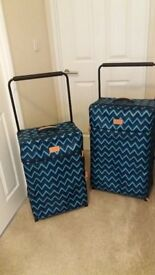 Two matching suitcases in perfect condition, only ever used once.