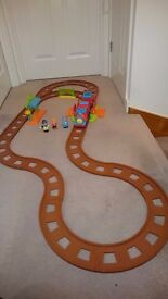 Happyland train set with additional track extension kit.