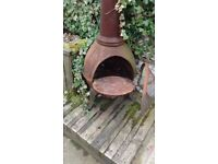Chimnea with cooking plate.