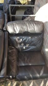 Black full leather 3 seater and armchair.
