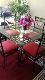 Glass table matchibg 4 chairs made from cast iron