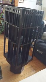 Modern black coloured wood rotating bookcase, size 46x46x133 (height)