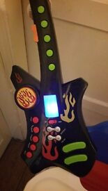Childs musical guitar