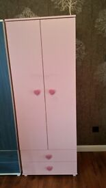 Pink wardrobe with heart accessories