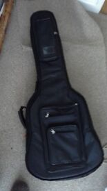 Gig bag for guitar, heavy duty, offers excellent protection, nearly new condition