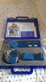 The Beauty Works Ltd. Body Toner, carry case, main unit, leads, reusable pads, straps. battery