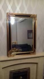 Stunning black and gold bevel edged mirror.