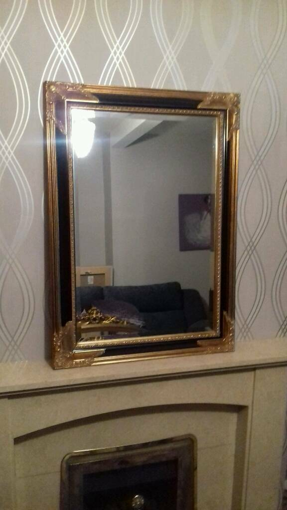 Stunning black and gold bevel edged mirror.