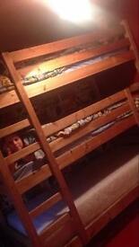 Wooden triple bunk beds