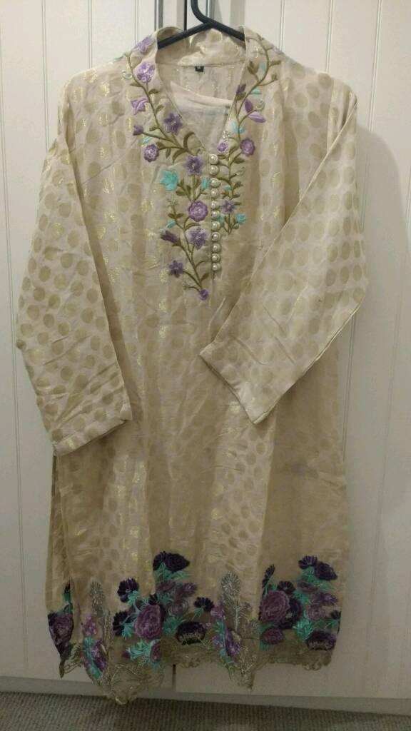 Brand new ladies design er stitched kurta medium size.