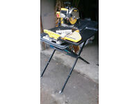 DeWalt D24000 Tile Saw and DW24000-1 Stand. Light use, nearly new diamond cutting blade.