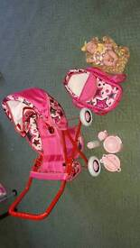 Toy pushchair with doll