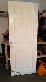 White wooden door with Gold handle