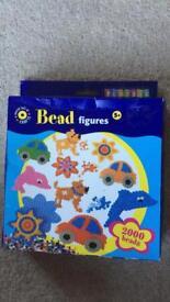 Brand new boxed bead set