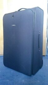 Tripp Suitcase - Large. Never Used, Excellent condition.