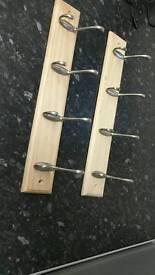 Wall mountable coat hangers