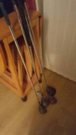 Golf clubs. 4 drivers and putter