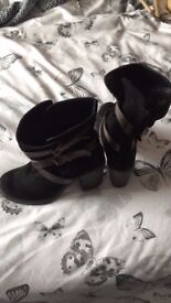 Black and brown suede boots