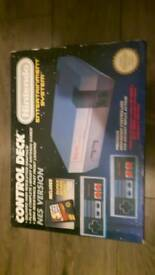 NINTENDO NES BOXED MINT CONSOLE 2 CONTROLLERS AND 8 GAMES