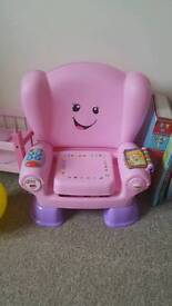 Pink fisher price laugh and learn talking chair