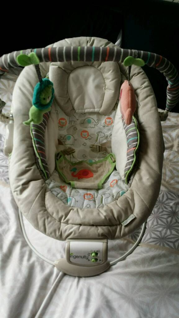 Baby bouncer with melodies and vibration and toys
