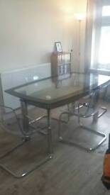 Dining table glass with four chairs