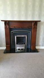 Fireplace with cast iron back and black marble base