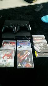Ps3 with 2 controller and games