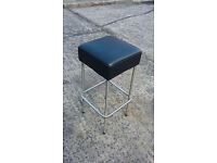 metal framed high stool with black leather padded seat