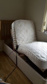 UNUSED Ex demo shop model. 2ft6 small single electric bed. Adjustable reclining lift up raise divan