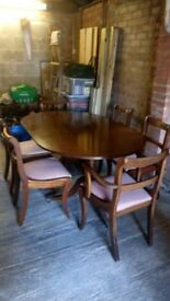 Mahogny dining table + 6 chairs