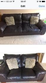Free 2 x dark brown leather sofas