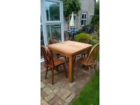 Solid oak table and four wheelback chairs