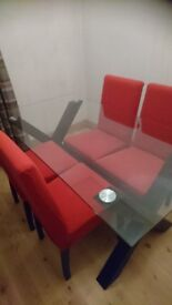 Reduced price!! Glass dining table and four chairs